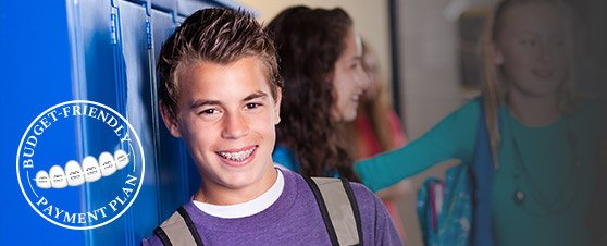 Smiling teen boy with braces