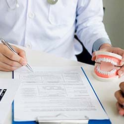 Older man and woman smiling with affordable implants