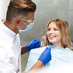 Man smiling while laying in dental chair