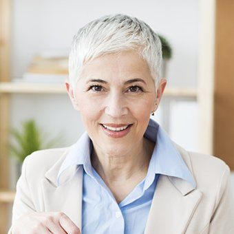 McKinney Restorative Dentistry Elderly lady smiling brightly