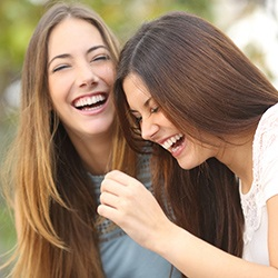 Two ladies laughing together