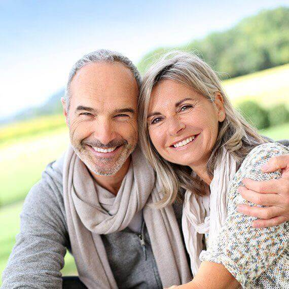 Smiling older couple with healthy teeth