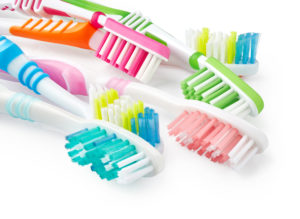 A variety of different colored toothbrushes