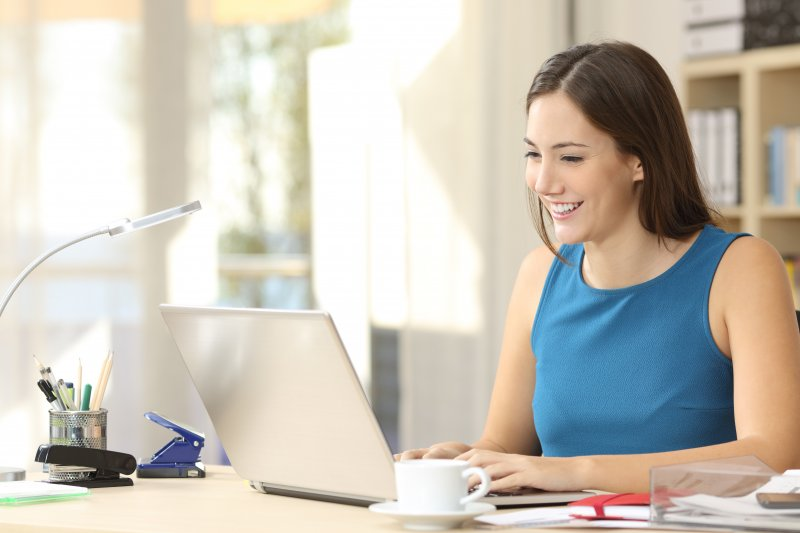 A woman learning how to find an Invisalign provider.